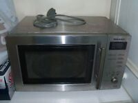 Microwave Silver full working order in good clean condition can deliver local only Eccles