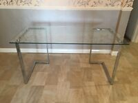 Glass desk - heavy, with metal legs.