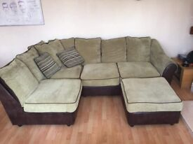 Corner sofa with separate foot rest