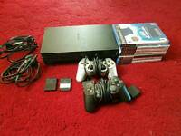 Ps2 2 pads 2 memory cards and games only 15 pounds