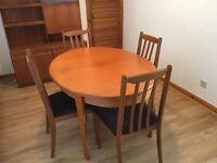 Teak dining room table + 4 chairs + matching wall cabinet