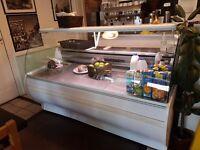 Drinks fridge, display cabinet and fruit basket