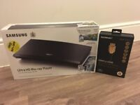 Brand New. Samsung Ultra HD Blu-ray player + Sandstorm Gold HDMI Cable **Unboxed.**