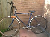 Raleigh Pioneer bicycle with lock