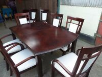 Large Mahogany Dining table with 8 Chairs and extendable Peace Delivery Available