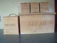 Matching wooden bread bin and biscuits, coffee, tea & sugar caddies. £6 ovno lot. Will split.