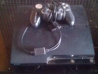 Playstation 3 and controller.