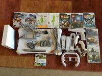 Nintendo Wii with games and assorted controllers
