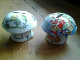 A pair of fine bone china money boxes