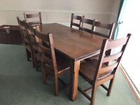 Stylish Dark Wood Large Table with 8 Matching Chairs. Excellent Item.