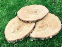Chainsaw cut log slices wedding table centre pieces decorations rustic natural wood