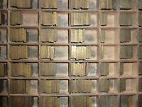 Letterpress type. Two trays of brass alloy headline type, plus three trays brass alloy small type