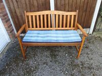 GARDEN BENCH IN GOOD CONDITION WITH A CUSHION