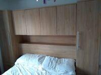 Oak veneer over the bed wardrobe