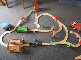 Wooden Train Set With Buildings, Vehicles and People.