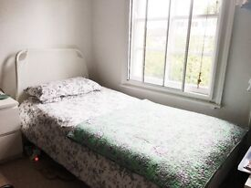 PRACTICALLY NEW SINGLE BED WITH MATTRESS