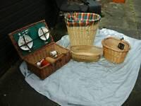 Four wicker basket items,picnic case,bike basket,laundry