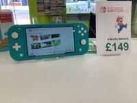 SWITCH LITE LIKE NEW !!BOXED!! COMES WITH 6MONTHS WARRANTY