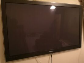 """Samsung PS50C6900 - 50"""" 3D TV with stand and remote. Lines across screen."""