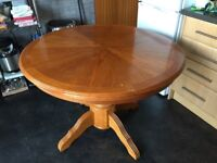 Dining table with extending leaf