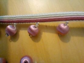 Shiny, thread covered pom pom trim