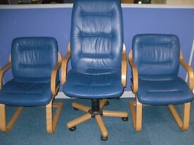 3 blue leather and wooden office chairs