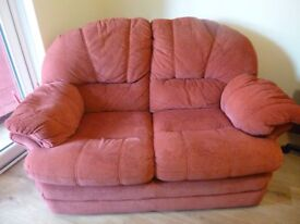 2 X two seater burgundy sofas.
