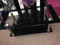 2 Matching black chrome glass tables