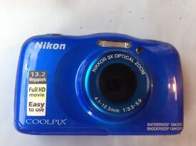 Nikon Coolpix W100 camera, blue, new condition comes with memory card and charger