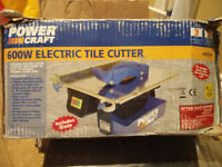 600 Watt electric water cooled tile cutter with two new blades