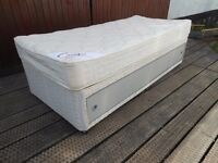 single divan bed with sliding drawer fronts in excellent condition.