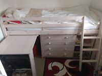 Pine midsleeper bed frame with desk and chest of drawers unit .