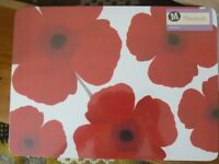 Brand new poppy design set of 4 table mats in original cellophane wrapping.