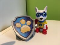 Paw patrol figure. Apollo Superpup action figure with shield badge.