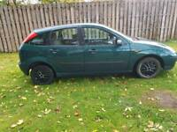 FORD FOCUS ZETEC**1.4 CL - CHEAP ON PETROL*** LARGE BOOT AREA ))).** LOW MILEAGE** 1 YEAR MOT