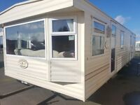 Cheap static caravan for sale with double lazing/Chapel/UNREAL LOCATION/On the beach/low ground rent