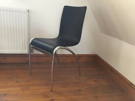 Black chair with chrome legs, modern elegant style for dinning room or study