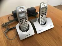 PANASONIC DIGITAL CORDLESS PHONES WITH ANSWER MACHINE AND CORDLESS HANDS FREE SETS.