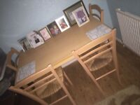 Table and four chairs amazing quality and good condition