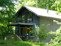 NEW PRICE; Chalet in woods with deeded WF on Whitefish Lake