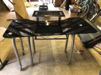 Corner desk with glass top and metal base