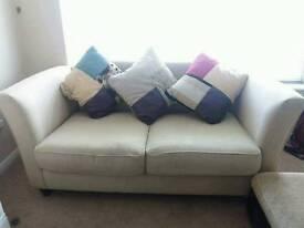 Three seater cream sofa