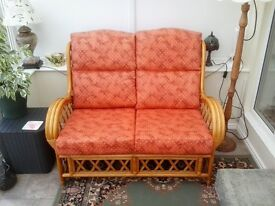 Two-seater cane sofa