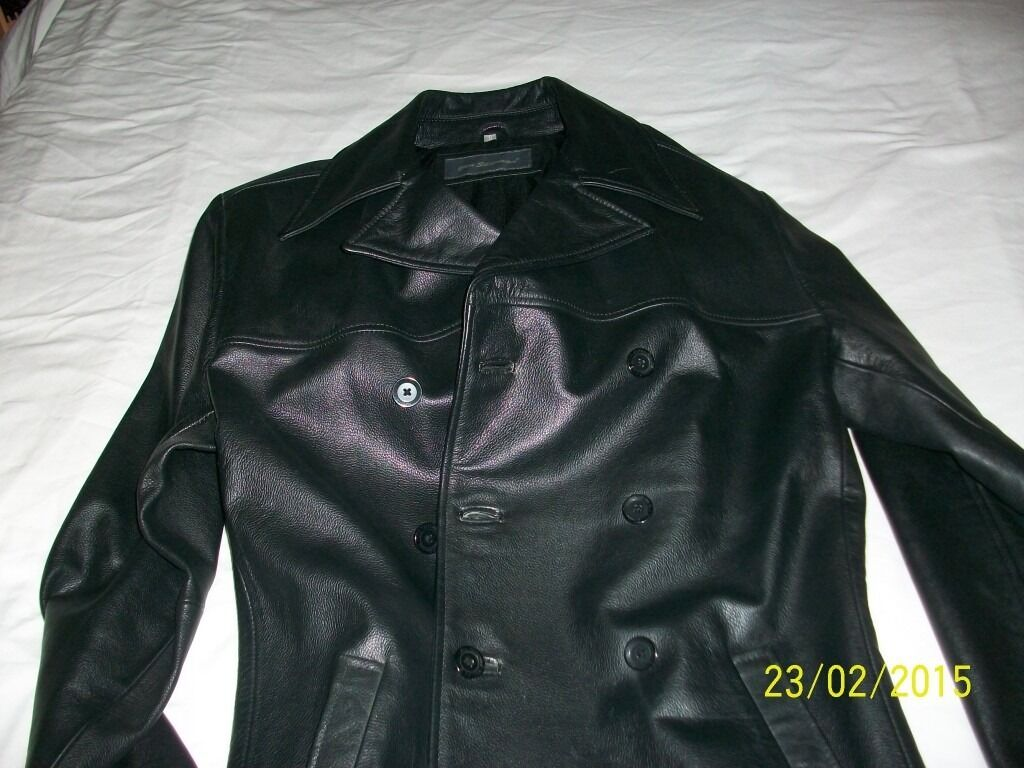Black Leather Jacket Ben Sherman size mediumin Wellingborough, NorthamptonshireGumtree - Unused (new but without tags)Medium size but a generous medium. Genuine leather Ben Sherman 35 inch coat length double breasted. Ideal for 40 – 44 inch chest in very good quality leather....bought as present but too long for me so never wore it....