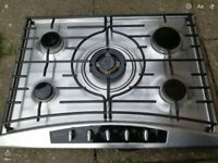 Gas hob with silver surround