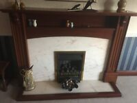 Gas Fireplace with Marble and Mahogany Fire Surround