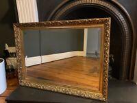 Ornate gold/bronze bevelled mirror