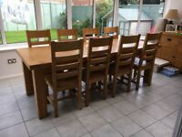 Solid oak extendable table and 8 chairs