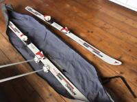 Skis and bindings, poles and carry case