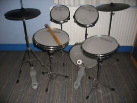 Full size silent drum kit. Mesh head snare, 3 toms & base drums. Plastic hi-hat & cymbals.
